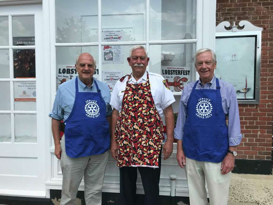 Rotary Club of New Canaan Lobsterfest Committee members Keith Simpson, Fred Baker and Scott Cluett, promote the Sept. 20-21 event at a display at the New Canaan Playhouse. Photo: Contributed Photo / Rotary Club Of New Canaan / New Canaan Advertiser Contributed