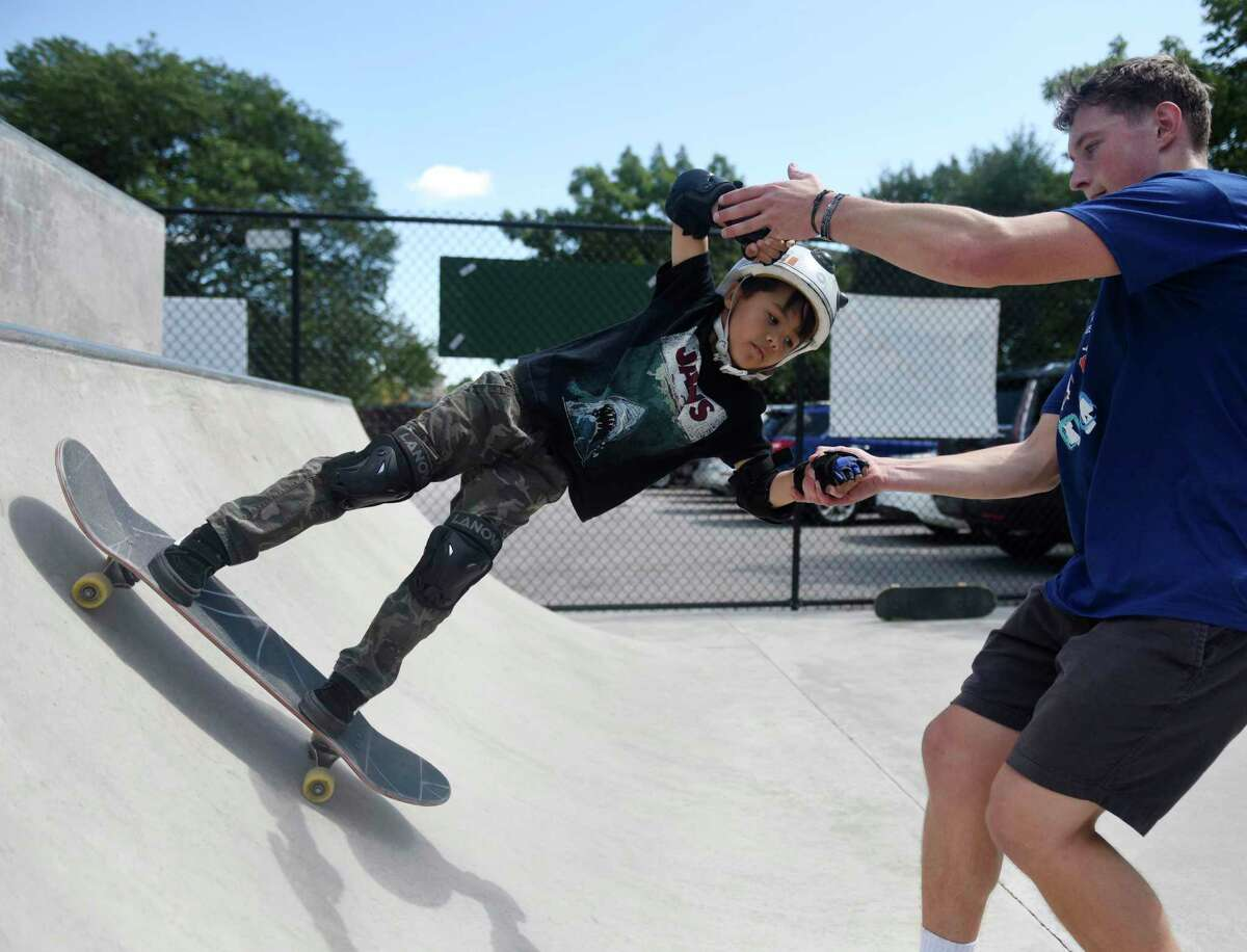 Leo Chu, 5, of Dobbs Ferry, N.Y. goes up the mini ramp with instructor Trevor Ingraham during a lesson at the Go Skate Festival at the Greenwich Skatepark in Greenwich, Conn. Saturday, Sept. 7. 29, 2019. The event, sponsored by Dental Oral Surgery, featured lessons for children from experienced skaters, followed by a competition for all ages and skill levels. More than 50 skaters participated in the lessons and competition.