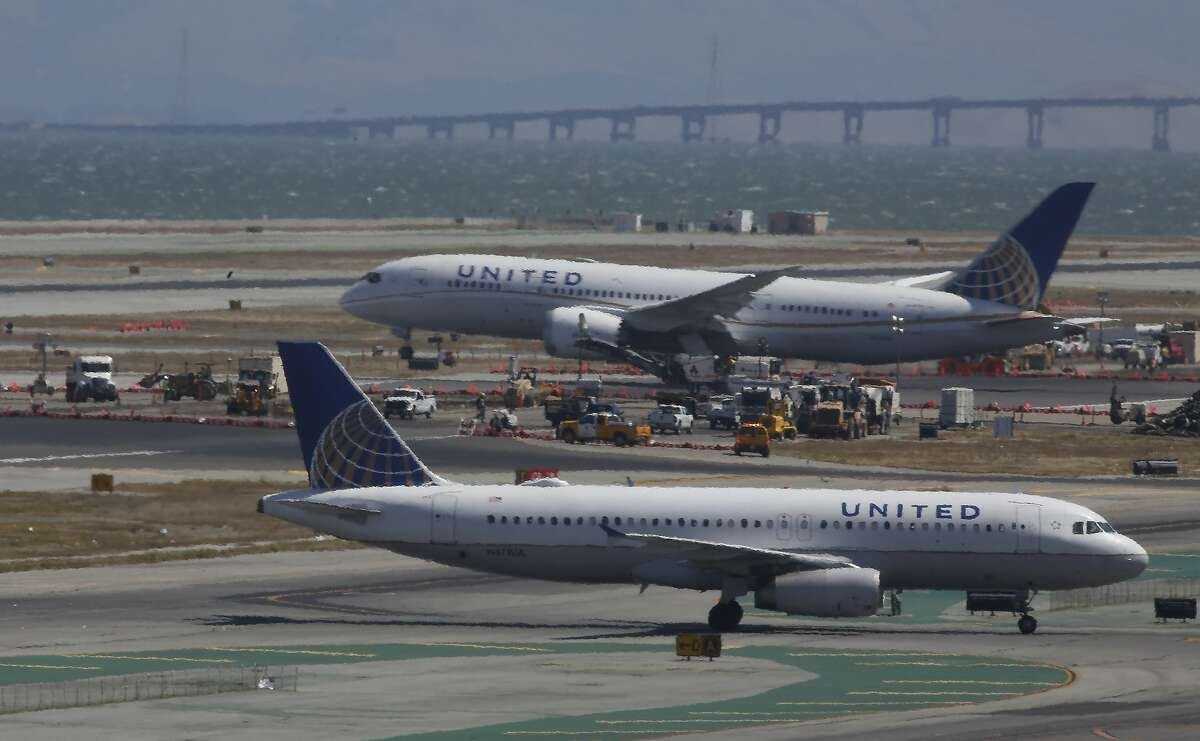 Airplanes are seen taking off and taxing next to construction equipment on a runway at San Francisco International Airport on Monday, September 9, 2019 at SFO in San Francisco, CA.
