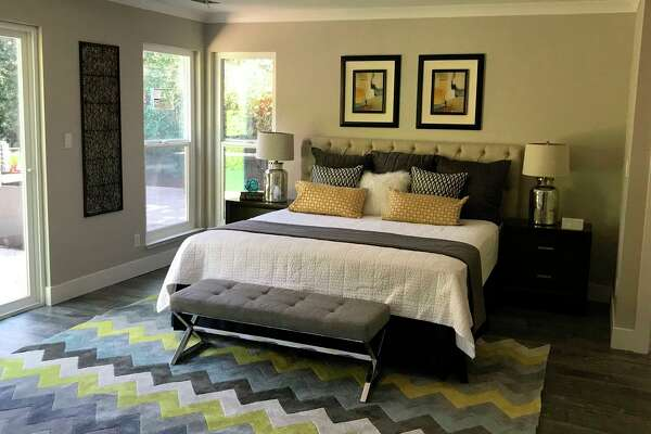This bedroom, designed and developed by Redwood City's Dream Team Development Group, opens to a landscaped backyard.