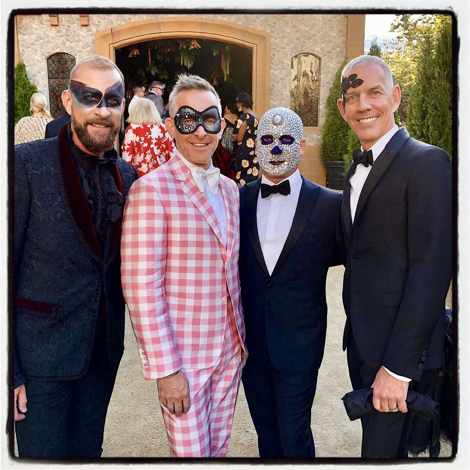 Masked men: Michael Purdy (from left), Jay Jeffers, Ronnie Genotti and David Oldroyd at the S.F. Opera Ball. Sept. 6, 2019. Photo: Catherine Bigelow / Special To The Chronicle