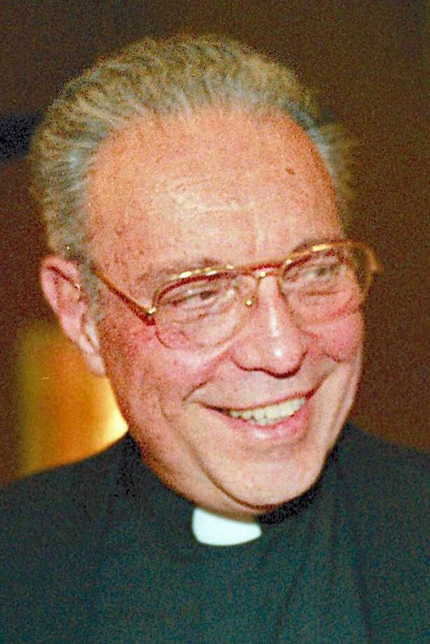 Monsignor William Genuario Photo: File Photo / File Photo / Connecticut Post File Photo