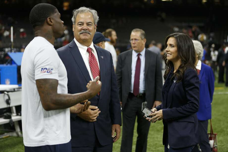 Cal McNair, Houston Texans chairman and CEO, and his wife Hannah talk to Andre Johnson before an NFL football game against the New Orleans Saints at the Mercedes-Benz Superdome on Monday, Sept. 9, 2019, in New Orleans. Photo: Brett Coomer/Staff Photographer