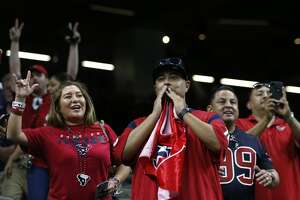 Houston Texans fans cheer as they watch warm ups before an NFL football game against the New Orleans Saints at the Mercedes-Benz Superdome on Monday, Sept. 9, 2019, in New Orleans.