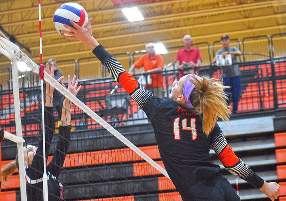 Edwardsville's Maddie Isringhausen goes up for an attack during a pool play match against Bloomington on Saturday. Photo: Matt Kamp|The Intelligencer