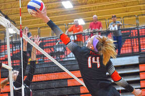 Edwardsville's Maddie Isringhausen goes up for an attack during a pool play match against Bloomington on Saturday.