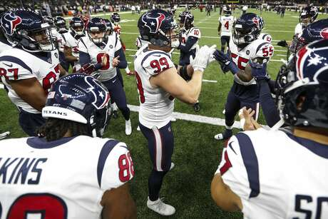 Houston Texans defensive end J.J. Watt (99) gathers his teammates on the field before and NFL football game against the New Orleans Saints at the Mercedes-Benz Superdome on Monday, Sept. 9, 2019, in New Orleans.