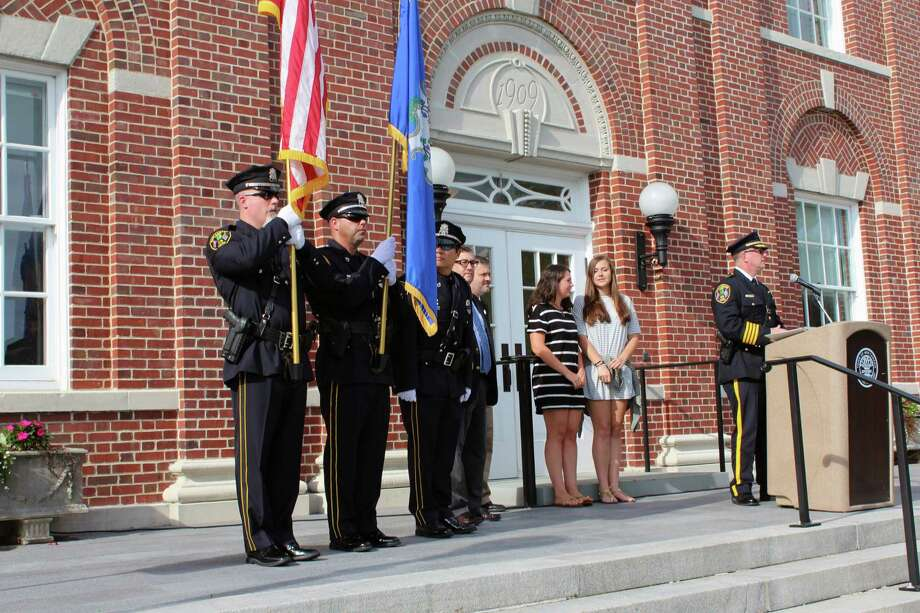 Police, fire and EMS personnel gather outside of New Canaan Town Hall at a previous 9/11 Memorial Ceremony in the municipality. Justin Papp / Hearst Connecticut Media Photo: Justin Papp / Hearst Connecticut Media / New Canaan News