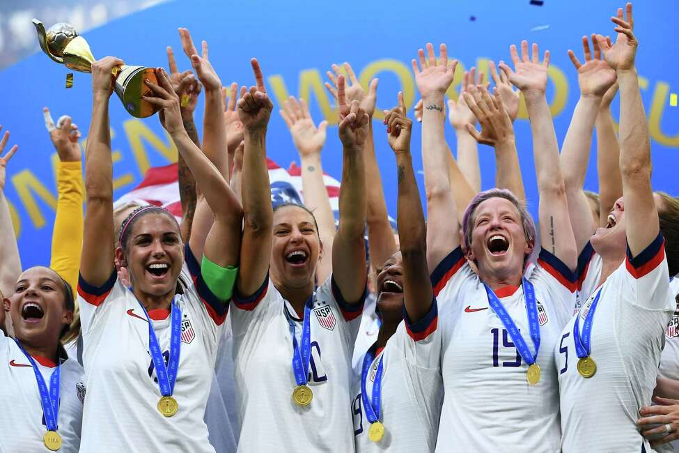 """The United States Women's National Soccer team celebrates after winning the 2019 Women's World Cup football final match between USA and the Netherlands, at the Lyon Stadium in Lyon, central-eastern France. US women's football players reached an impasse August 14, 2019, in mediation with the US Soccer Federation in their dispute over equal pay with the American men's squad. Molly Levinson, a spokesperson for the US women's players, said the group will """"eagerly look forward to a jury trial."""" (Photo by FRANCK FIFE / Getty Images"""
