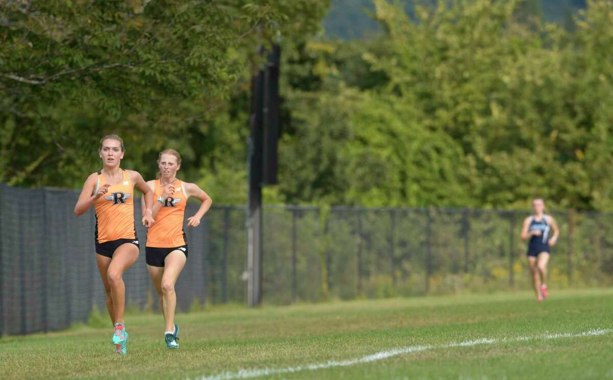 Ridgefield High Schools Tess Pisanelli, left, finished first closely followed by team mate Katherine Rector in second. Cross Country meet at Ridgefield High School including teams from Ridgefield High School, Fairfield Warde, Stamford High School and Wilton High School. Monday, September 9, 2019, in Ridgefield, Conn.