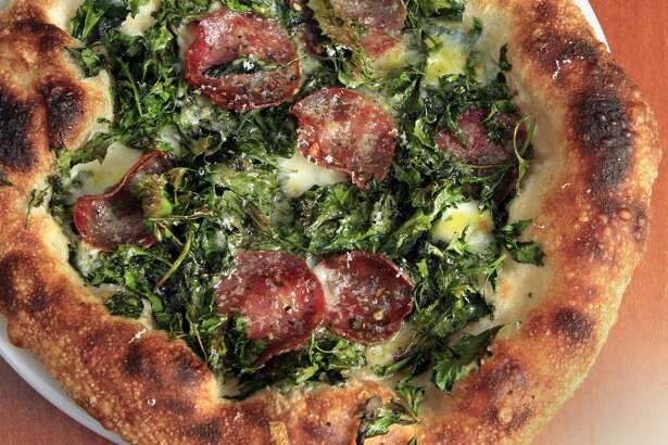 Wild Spinach pizza, s served at Pizzeria Mozza in Newport Beach on December 15, 2011. (Photo by Glenn Koenig/Los Angeles Times via Getty Images)