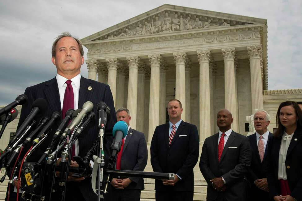Texas Attorney General Ken Paxton and a bipartisan group of state attorneys general speaks to reporters in front of the U.S. Supreme Court in Washington, Monday, Sept. 9, 2019 on an antitrust investigation of big tech companies. (AP Photo/Manuel Balce Ceneta)