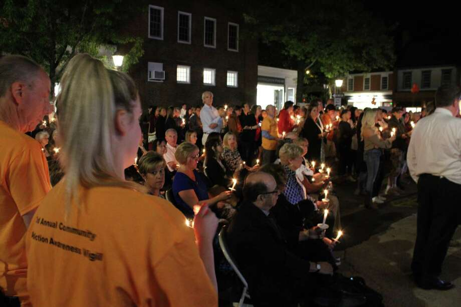 Candles display hope and unity in the fight against addiction during New Canaan's third annual Addiction Awareness Vigil Thursday, Sept. 5, at the corner of South Avenue and Elm Street. Photo: John Kovach / Hearst Connecticut Media / New Canaan Advertiser