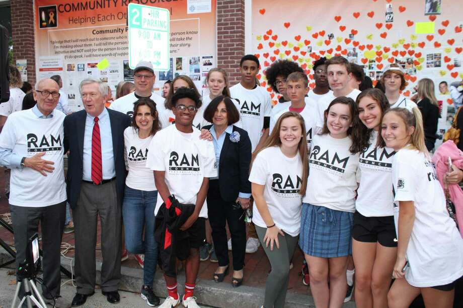 First Selectman Kevin Moynihan and former state Sen. Toni Boucher mingle with the New Canaan High School Ram Council on Thursday, Sept. 5, when New Canaan hosted its third annual Addiction Awareness Vigil. Photo: John Kovach / Hearst Connecticut Media / New Canaan Advertiser