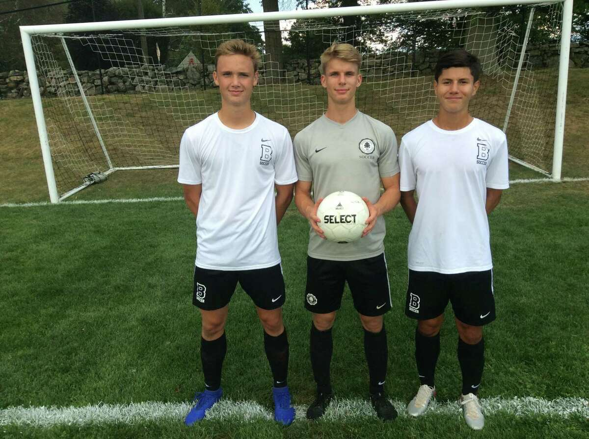 From left to right, Henry Foster Eric Meindl and Steve Lopez are senior captains of the Brunswick School soccer team.