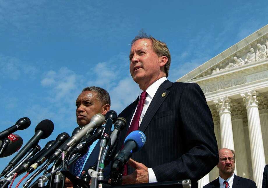 "District of Columbia Attorney General Karl Racine (L) and Texas Attorney General Ken Paxton speak during the launch of an antitrust investigation into large tech companies outside of the US Supreme Court in Washington, DC on September 9, 2019. - The backlash against Big Tech heads into a new phase Monday with another broad antitrust investigation, highlighting the mounting legal challenges facing the dominant online platforms. Top legal officials from dozens of US states were set to unveil a probe of Google over allegations of ""anticompetitive behavior,"" days after a separate coalition announced a similar investigation of social networking giant Facebook. (Photo by MANDEL NGAN / AFP)MANDEL NGAN/AFP/Getty Images Photo: MANDEL NGAN, Contributor / AFP/Getty Images / AFP or licensors"