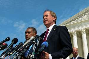 "District of Columbia Attorney General Karl Racine (L) and Texas Attorney General Ken Paxton speak during the launch of an antitrust investigation into large tech companies outside of the US Supreme Court in Washington, DC on September 9, 2019. - The backlash against Big Tech heads into a new phase Monday with another broad antitrust investigation, highlighting the mounting legal challenges facing the dominant online platforms. Top legal officials from dozens of US states were set to unveil a probe of Google over allegations of ""anticompetitive behavior,"" days after a separate coalition announced a similar investigation of social networking giant Facebook. (Photo by MANDEL NGAN / AFP)MANDEL NGAN/AFP/Getty Images"