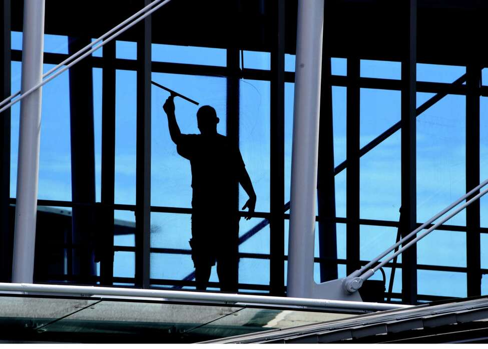 A window washer is seen working in the walkway connecting the garage to the terminal at the Albany International Airport on Monday, Sept. 9, 2019 in Colonie, N.Y. (Lori Van Buren/Times Union)