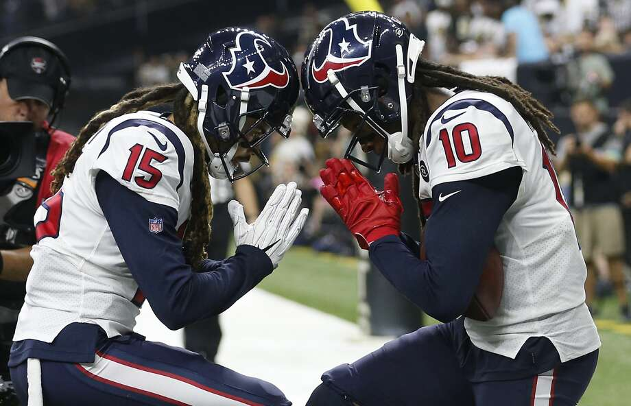 PHOTOS: Texans vs. Chiefs Houston Texans wide receivers Will Fuller (15) and DeAndre Hopkins (10) celebrate Hopkins' 2-yard touchdown reception against the New Orleans Saints during the second quarter of an NFL football game at the Mercedes-Benz Superdome on Monday, Sept. 9, 2019, in New Orleans. >>>See more photos from the Texans' win over the Chiefs on Sunday ... Photo: Brett Coomer/Staff Photographer