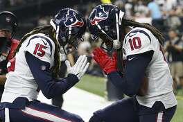 Houston Texans wide receivers Will Fuller (15) and DeAndre Hopkins (10) celebrate Hopkins' 2-yard touchdown reception against the New Orleans Saints during the second quarter of an NFL football game at the Mercedes-Benz Superdome on Monday, Sept. 9, 2019, in New Orleans.