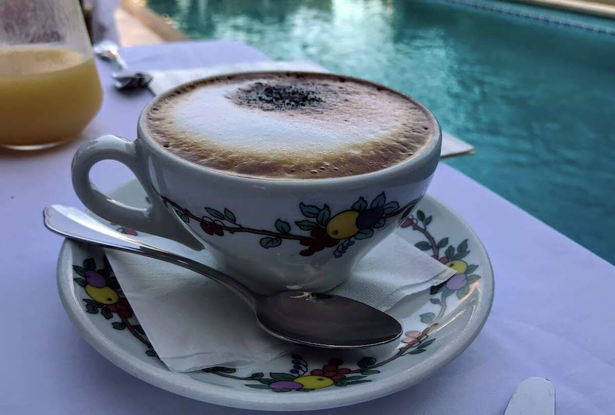 Cappuccino (for breakfast only!) served poolside by our friendly waiter Giovanni at Hotel Villa Brunella on Capri. Perfect!