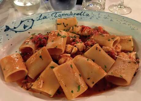 Big round and chewy paccheri pasta, a local favorite in the Amalfi area, served piping hot with an amberjack and tomato sauce. I did not ask for parmesan with this! Photo: Chris McGinnis