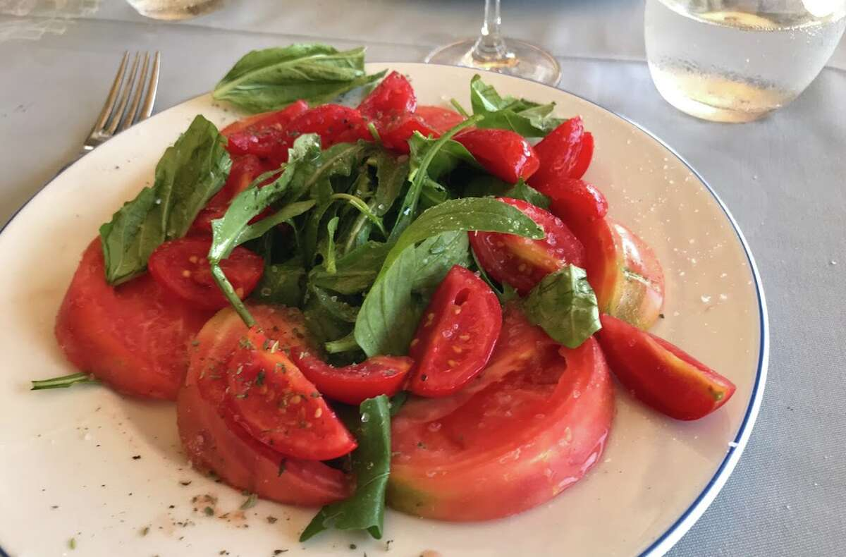 As you might imagine, a simple tomato and arugula salad is the perfect starter on a hot day in Capri