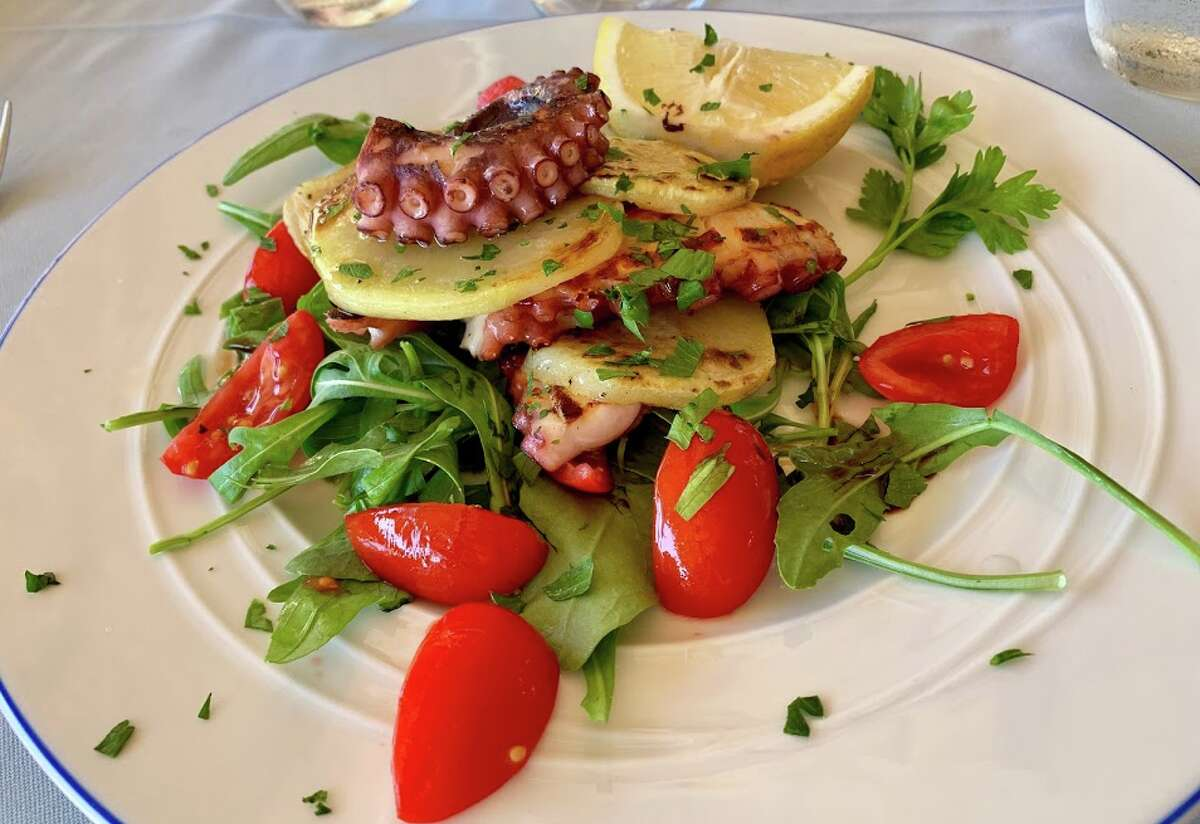 A delicately chewy octopus starter served with sliced potatoes, arugula and tomatoes served at La Fontelina beach club on Capri.