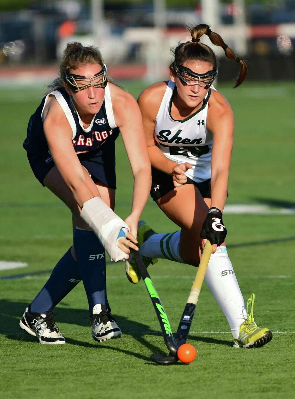Saratoga's Danielle Geils, left, and Shenendehowa's Grace DeChiro battle for the ball during a field hockey game on Monday, Sept. 9, 2019 in Clifton Park, N.Y. (Lori Van Buren/Times Union)