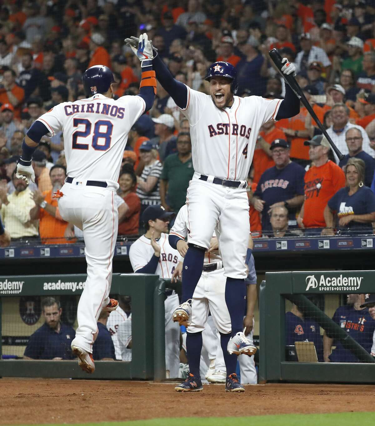 Houston Astros Robinson Chirinos (28) celebrates his two-run home run with George Springer (4) during the first inning of an MLB baseball game at Minute Maid Park, Monday, Sept. 9, 2019, in Houston.