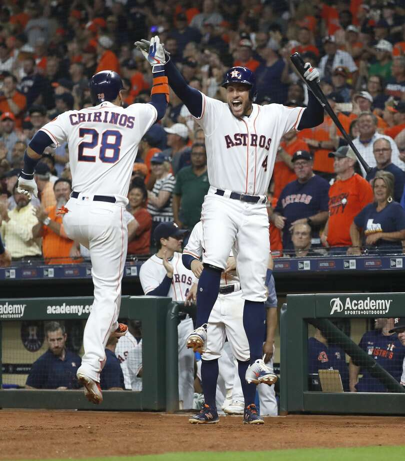 Houston Astros Robinson Chirinos (28) celebrates his two-run home run with George Springer (4) during the first inning of an MLB baseball game at Minute Maid Park, Monday, Sept. 9, 2019, in Houston. Photo: Karen Warren/Staff Photographer