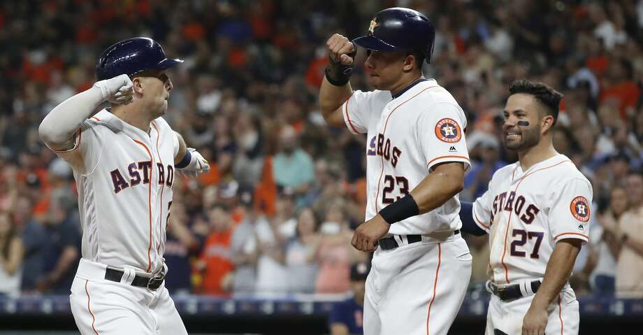 Houston Astros Alex Bregman (2) celebrates his three-run home run with Michael Brantley (23) during the first inning of an MLB baseball game at Minute Maid Park, Monday, Sept. 9, 2019, in Houston. Photo: Karen Warren/Staff Photographer