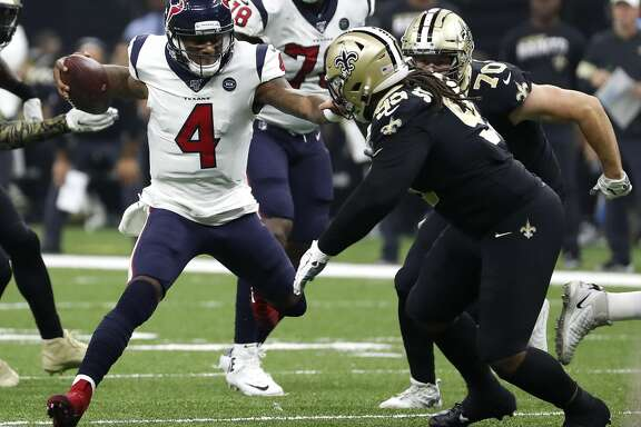 Houston Texans quarterback Deshaun Watson (4) cuts back against New Orleans Saints defensive tackle Shy Tuttle (99) as he scrambles out of the pocket during the second quarter of an NFL  football game at the Mercedes-Benz Superdome on Monday, Sept. 9, 2019, in New Orleans.
