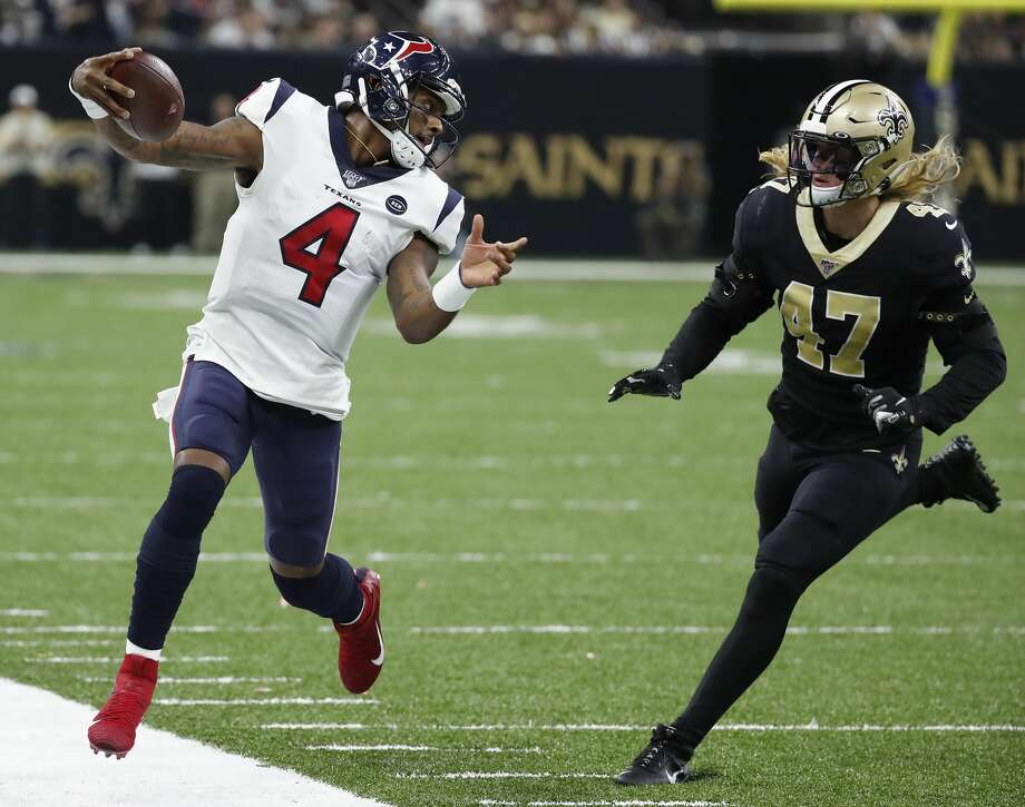 PHOTOS: Deshaun Watson against the Saints on Monday night Houston Texans quarterback Deshaun Watson (4) runs to a first down past New Orleans Saints middle linebacker Alex Anzalone (47) during the third quarter of an NFL  football game at the Mercedes-Benz Superdome on Monday, Sept. 9, 2019, in New Orleans. Photo: Brett Coomer/Staff Photographer