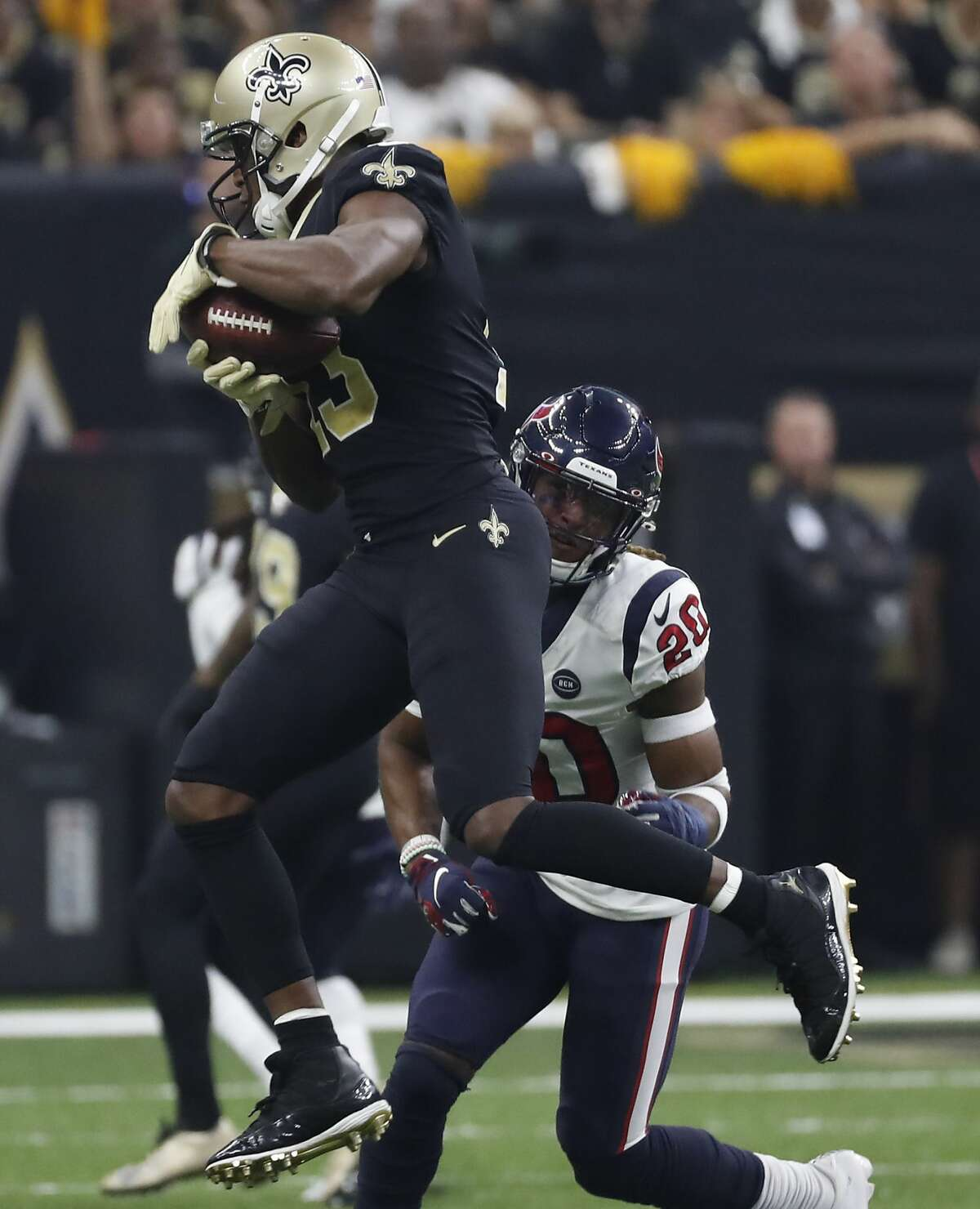 New Orleans Saints wide receiver Michael Thomas (13) pulls down a reception in front of Houston Texans strong safety Justin Reid (20) during the second quarter of an NFL football game at the Mercedes-Benz Superdome on Monday, Sept. 9, 2019, in New Orleans.