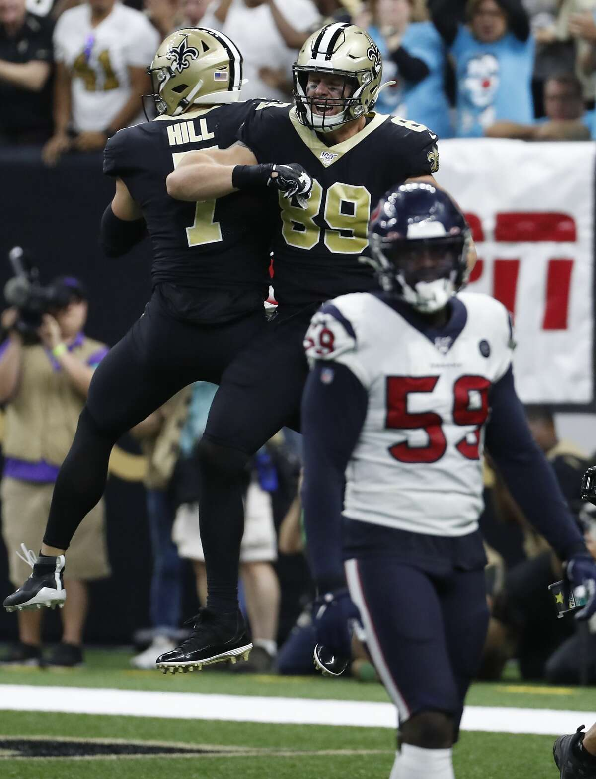 New Orleans Saints quarterback Taysom Hill (7) and tight end Josh Hill (89) celebrate Hill's 9-yard touchdown reception against the Houston Texans during the third quarter of an NFL football game at the Mercedes-Benz Superdome on Monday, Sept. 9, 2019, in New Orleans.