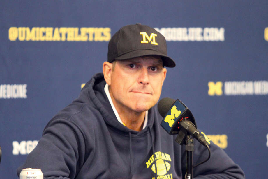 University of Michigan football coach Jim Harbaugh speaks with reporters after the Wolverines' 24-21, double-overtime victory over Army in Ann Arbor Saturday. Photo: Eric Rutter/Huron Daily Tribune