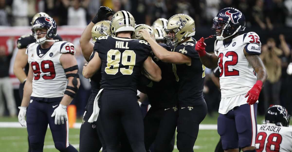 New Orleans Saints kicker Wil Lutz is mobbed by his teammates after kicking a 58-yard field goal as time ran out to beat the Houston Texans 30-28 at the Mercedes-Benz Superdome on Monday, Sept. 9, 2019, in New Orleans.