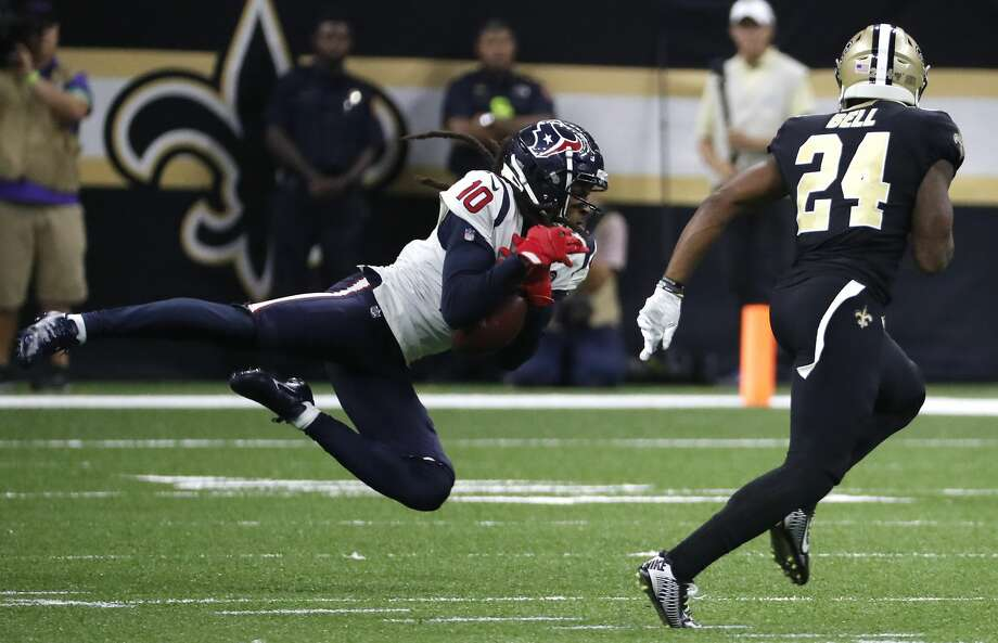 PHOTOS: Texans vs. Saints  Houston Texans wide receiver DeAndre Hopkins (10) makes a first down reception against New Orleans Saints strong safety Vonn Bell (24) during the fourth quarter of an NFL  football game at the Mercedes-Benz Superdome on Monday, Sept. 9, 2019, in New Orleans. Photo: Brett Coomer/Staff Photographer
