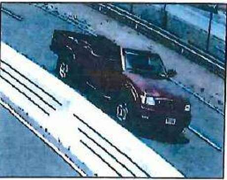 Security footage shows the red Toyota Tacoma police believe Fotis Dulos was driving the day his wife disappeared traveling northbound on the Merritt Parkway passing the New Canaan rest area at 11:12 a.m. May 24, the arrest warrant said. Photo: Connecticut State Police