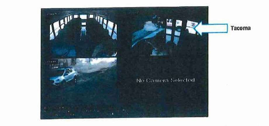 A New Canaan school bus security video captures the red Toyota Tacoma parked in a turnout on Lapham Road near Waveny Road at 7:40 a.m. May 24, the warrant said. Photo: Connecticut State Police