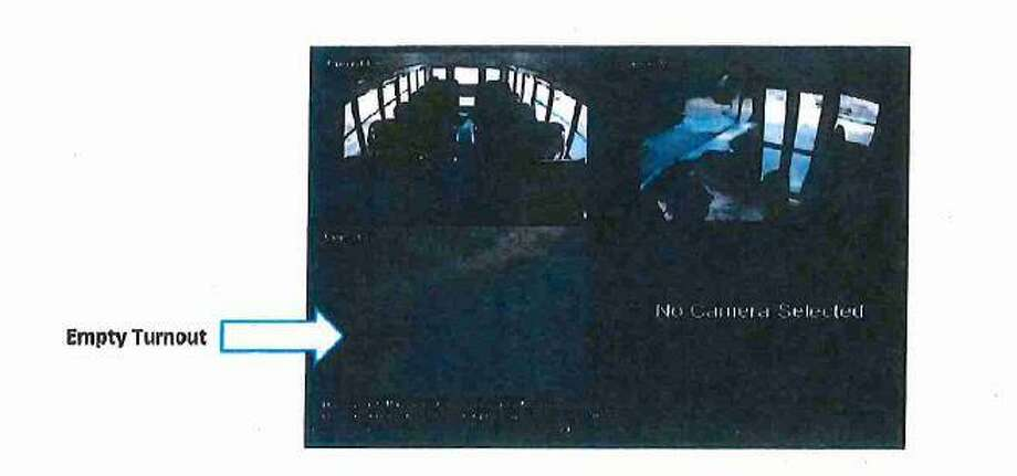 New Canaan school bus security footage shows an empty turnout on Lapham Road at 7:05 a.m. May 24. Police said they believe Fotis Dulos arrived minutes later and parked the red Toyota Tacoma. Photo: Connecticut State Police