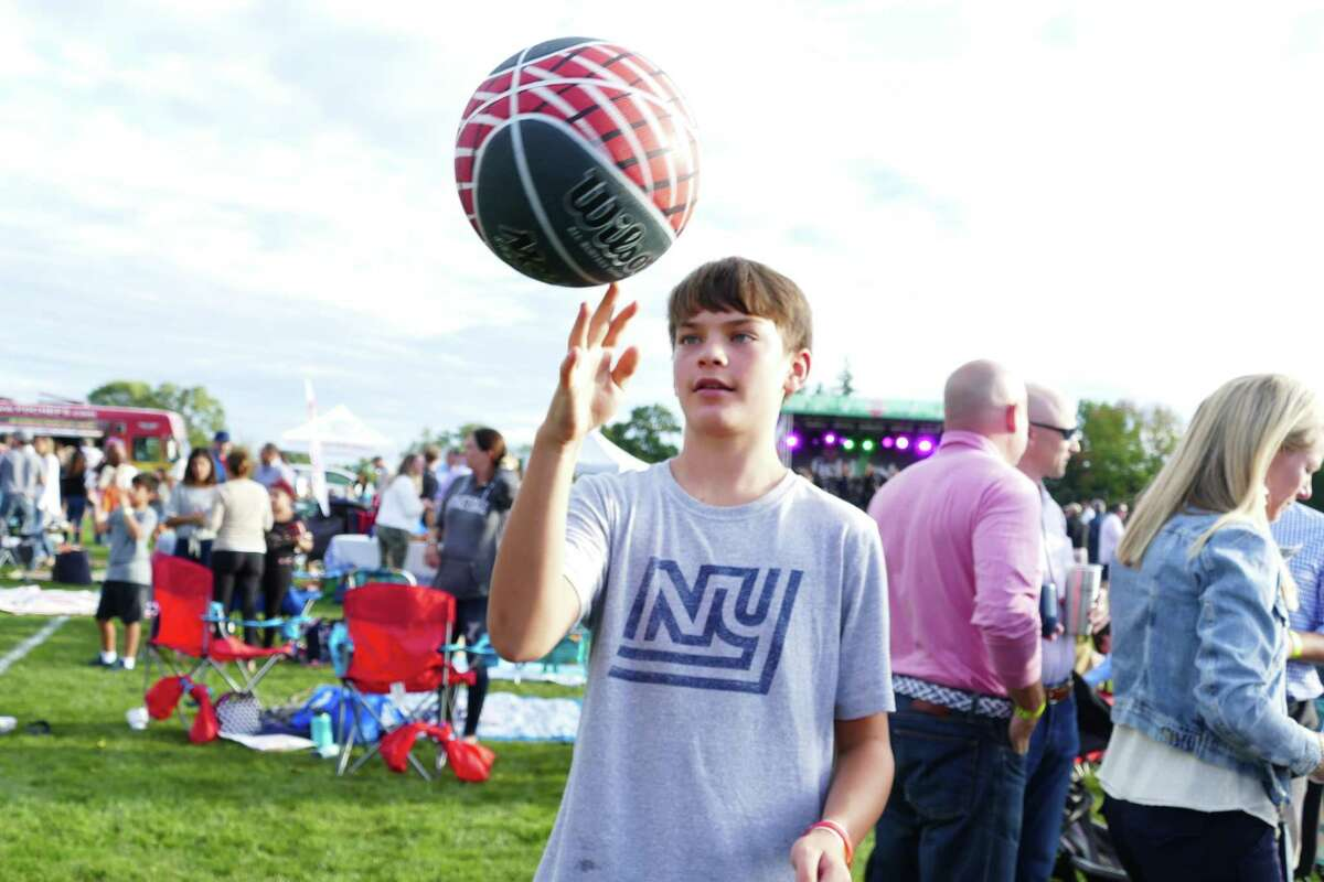 Alex Russey twirled a basketball on one finger in Coppo Field at the Fieldfest, put on by the New Canaan Athletic Foundation, on Sept. 7.
