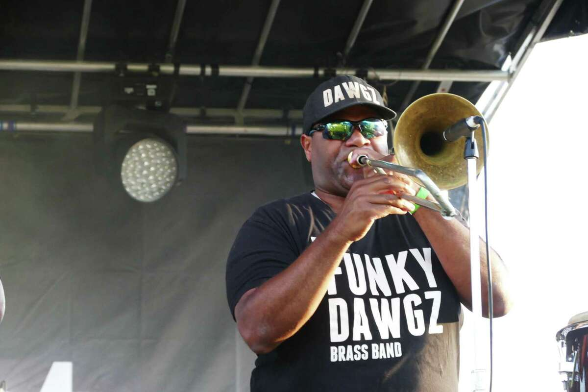 The Funky Dawgz treated New Canaan to music in New Orleans' tradition as Marvin McNeil played his trombone at the Fieldfest.