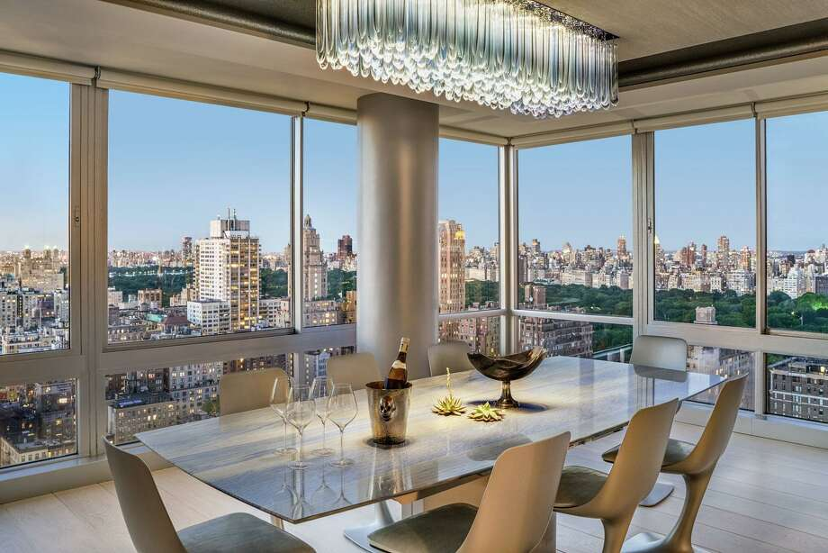 This New York City apartment, which uses a Savant home automation system installed by Stamford-based Rich AV Design to bring together TVs, music (via invisible speakers), HVAC control, and motorized shades by both Lutron and Savant, as well as a custom Ketra/Lutron human centric lighting system, won the 2018 Silver Award for Electronic House Home of the Year. Photo: David Allee / / Connecticut Post