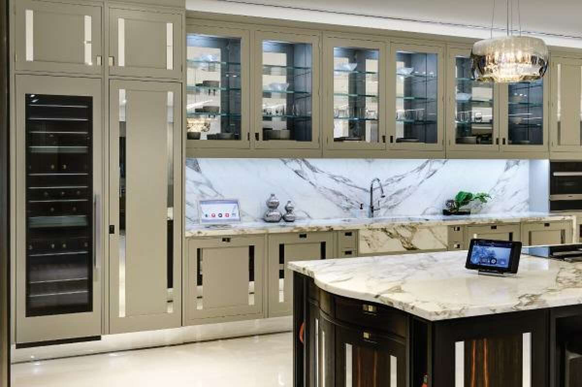 Crestron kitchen touchscreens - which control this kitchen's lights, sound, and temperature - help make cooking a pleasure. Smarthome and Theater Systems, a smart home technology company, can complete similar installations for homeowners.