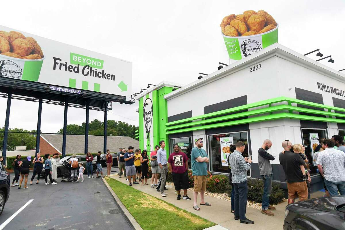 Consumers stand in line at an Atlanta-based KFC throughout the day to be among the first to try Beyond Fried Chicken, a plant-based chicken made in partnership with Beyond Meat, on Tuesday Aug. 27, 2019.