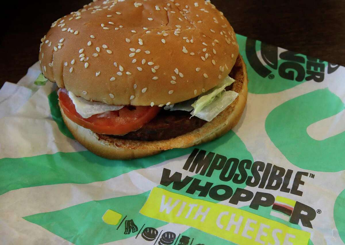 In this Wednesday, July 31, 2019 photo, an Impossible Whopper burger is photographed at a Burger King restaurant in Alameda, Calif. Burger King will soon offer its Impossible Whopper plant-based burger nationwide. The chain said the soy-based burger, made by Impossible Foods, will be available for a limited time at its 7,000 U.S. stores starting next week. (AP Photo/Ben Margot)