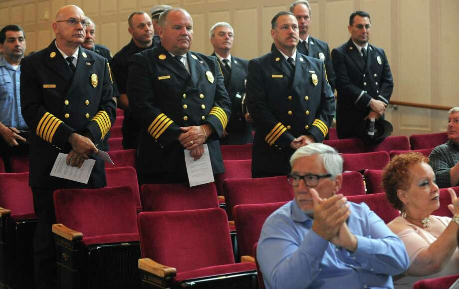 Firefighters are recognized during Norwalk's annual 9/11 remembrance Sept. 11, 2018, in the concert hall at Norwalk City Hall in Norwalk, Conn. Mayor Harry Rilling and other elected officials were joined by the city's first responders to honor those lost in the 2001 terror attacks. Photo: Erik Trautmann / Hearst Connecticut Media / Norwalk Hour