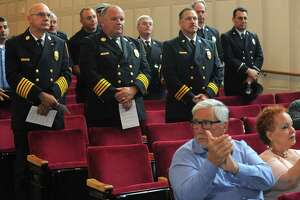 Firefighters are recognized during Norwalk's annual 9/11 remembrance Sept. 11, 2018, in the concert hall at Norwalk City Hall in Norwalk, Conn. Mayor Harry Rilling and other elected officials were joined by the city's first responders to honor those lost in the 2001 terror attacks.